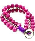 Rosa armband med stenar