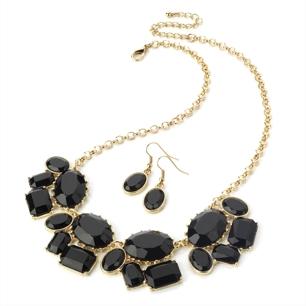 Halsband svart statement med gulddetaljer