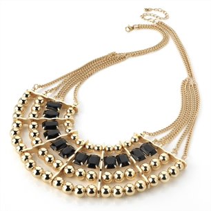 Halvmånformat halsband i svart & guld