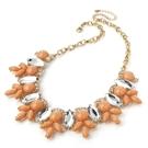 Populärt statement halsband i aprikost & guld