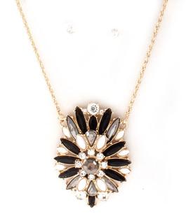 Halsband i svart, vitt & guld med matchande örhängen