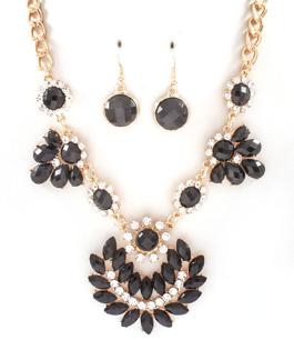 Halsband i svart, vitt och guld med matchande örhängen
