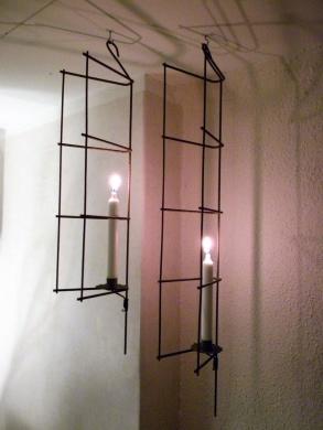 En hängande ljusstake i två längder.