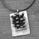 Oxiderat silver /läder