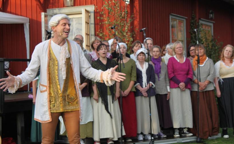 Bellman [Henning Landin] & kören Karins Änglar. Foto: Mats Anderling