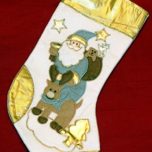 Julstrumpa, Tomte och gris i guld