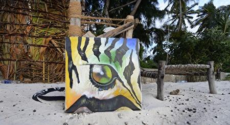 fina målningar överallt, den här låg och skräpade på stranden en morgon...