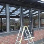 Fasta fönster med utåtgående dörr