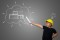 vecteezy_young-boy-wearing-a-yellow-engineer-hat-and-house-plan-ideas-on-a-blackboard_1923317
