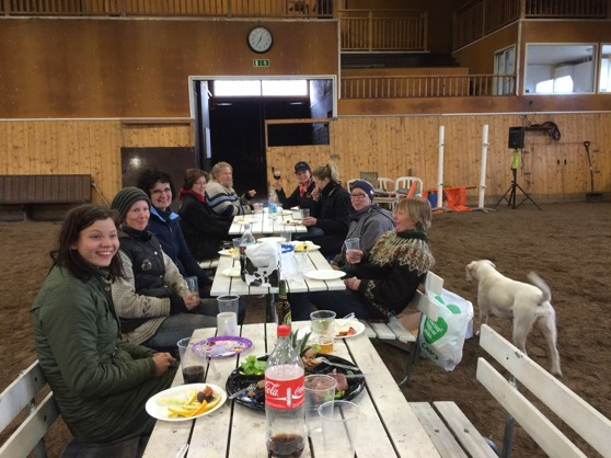 "Nice dinner with the students this evening. "" If its cold outside, you better bring the table inside the riding arena ;-) """