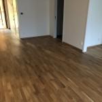 Vi har levererat trägolv från Tarkett och lagt in det i 30st lägenheter