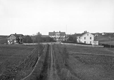 2. Nygård i centrala Töcksfors i början av 1900-talet. Foto : Axel Gunnar Ödvall / Årjängs kommuns billdbank