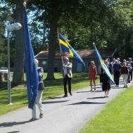 Fanborgen på Västrumsdagen på väg till kyrkogården