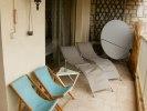 Balcony with sun beds