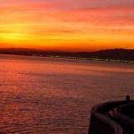 Vy över solnedgång från balkong