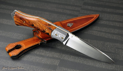 """""""Buscrafter""""- Sandvik 12c27 blade with Damasteel bolsters, Boxelder burl scales and fileworked Bronze liners."""