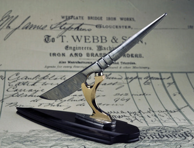 """Desk """"Scalpel"""" - Damasteel blade attached witha magnet to a stand made with African Blackwood, Damasteel and Bronze."""