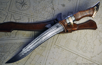 Carbon steel damascus, Ash burl, Nickel silver and Bronze fighter.