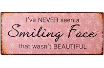 IB Laursen Metall skylt: I´ve never seen a smiling face...