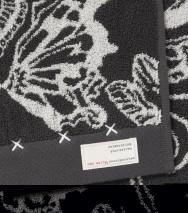Odd Molly frotté gästhandduk, Daybreak butterfly, Asphalt (30x50)
