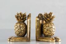 Bokstöd med guldfärgad ananas