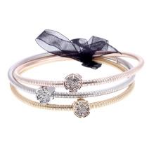 Gemini Armband elastiskt i metall med blomma och vita stenar