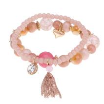 Gemini Armband, elastiskt rosa med pärlor och tofs