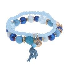 Gemini Armband, elastiskt blått med pärlor och toffs