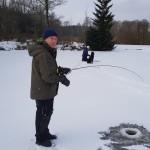 Mattias Palmqvist med fisk på kroken