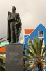A statue and colorful houses at Willemstad, Curacao