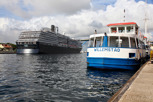 Cruise ship and local transportation boat at Willemstad, Curacao