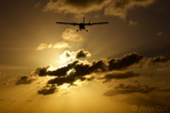 Winair De Havilland Twin Otter over Maho Beach during sunset, Sint Maarten