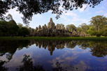 Bayon temple mirrored in a puddle, Angkor Thom