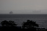 Bad weather passes by the Öresund with a Scandlines ferry and Kronborg Castle in the distance, Helsingborg