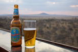 Safari Lager with Serengeti National Park as backdrop