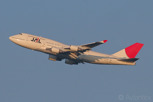 Japan Airlines Boeing 747-400 departing at sunset