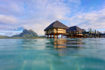 Overwater bungalows at Pearl Beach Resort with Mount Otemanu as backdrop, Bora Bora