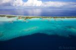 Bora Bora lagoon with overwater bungalow resorts side by side, Tahiti