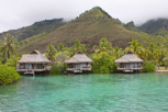 Overwater bungalows against the mountainous terrain at Moorea