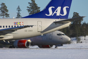 Two 737-600 at a cold and snowy Stockholm/Arlanda.
