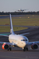 A Boeing 737-600 taxiing to gate after landing while an A330-300 is about to touching down on rwy 19L at Stockholm/Arlanda