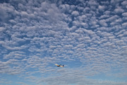 Beautiful cloud formations at Stockholm/Arlanda just as a Boeing 737-700 climbs away after departure.