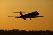 A MD80 about land at Copenhagen/Kastrup at sunset
