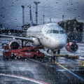 An Airbus A320 standing in the rain at Copenhagen/Kastrup waiting for departure