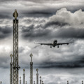 An Airbus A340-300 on final approach to 22L at Copenhagen/Kastrup under threathening skies