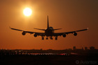 A Boeing 747-400 about to land during sunrise