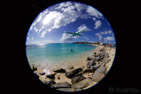 Air France Airbus A340-300 on final over Maho Beach at Sint Maarten in a fish eye perspective
