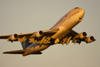 Saudi Arabian Airlines Boeing 747-400 on departure in golden light conditions