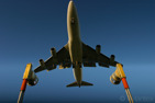 A Boeing 747-400 over the approach lights