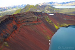 Blue crater hole and red sand cliff, Landmannalaugar
